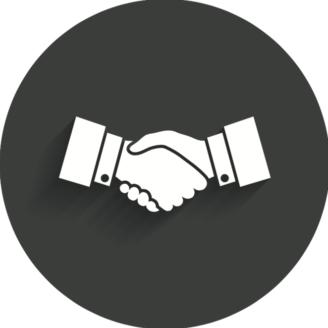 Två händer i ett handslag