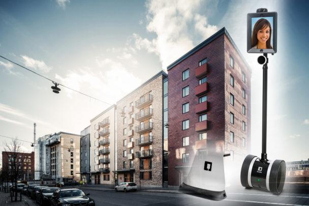 Fasaden på ett lägenhetskomplex med bilden av en robot monterad framför