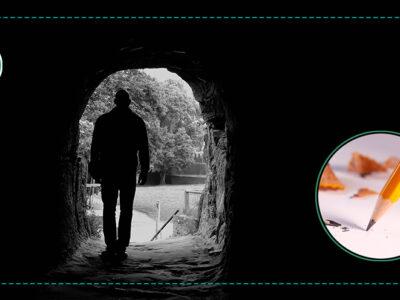 Silhuetten av en person som går genom en mörk tunnel