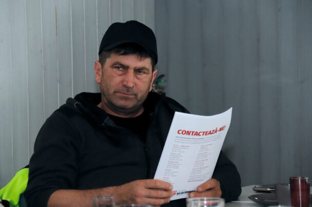 Claudiu Fărcaș holding some papers